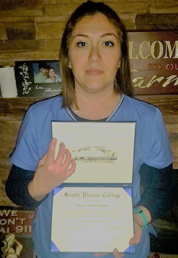 A photo of Marissa Ceniceros holding her certificate