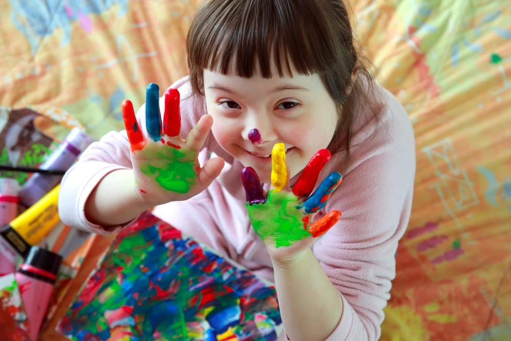 A Young child playing with finger paint