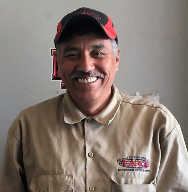 A photo of Candelario Olivas smiling