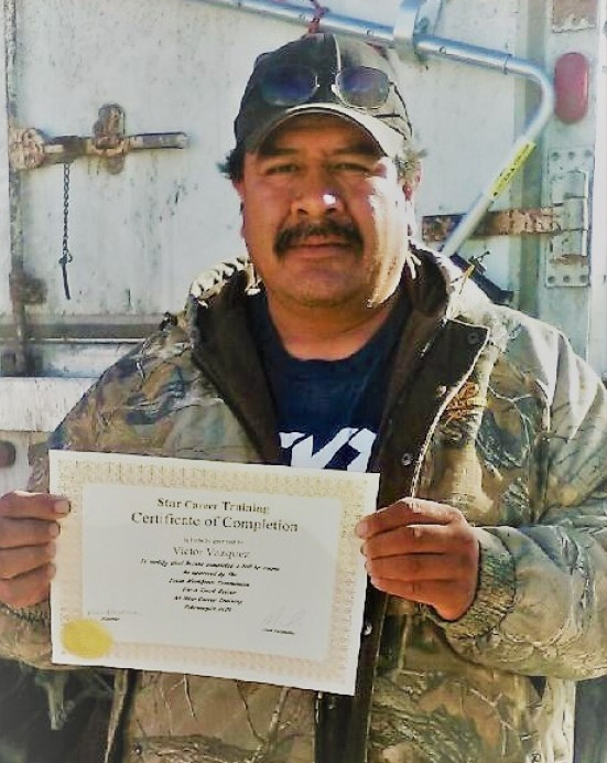 A photo of Victor Vasquez holding his certificate