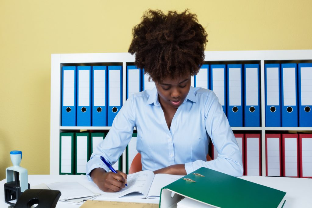 Young woman working in an office.